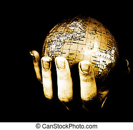 Globe in a girl's hands. Macro image isolated on black
