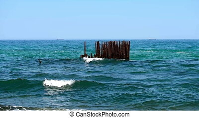 old pier - perfect sky and water of ocean with old pier