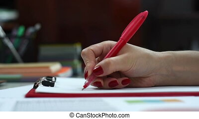 Businesswoman signs contract - Businesswoman with red pen...