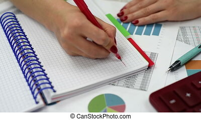 woman drawing chart - woman hands drawing stock chart, close...
