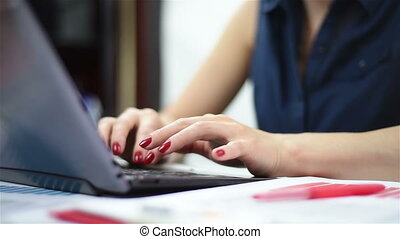 Woman hands typing on a laptop, extra close up