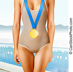 swimmer with gold medal - Part of beautiful swimmer wearing...