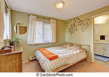 Bright bedroom with green walls.