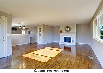 Hardwood living room with fireplace. - Hardwood living room...