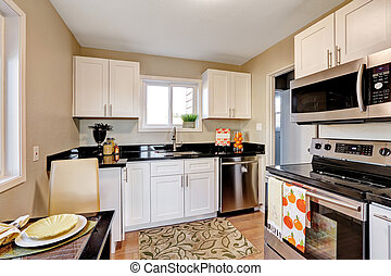 nice kitchen with black counters.