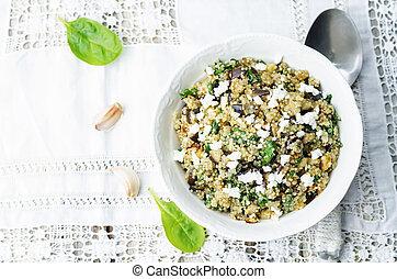 quinoa spinach eggplant feta salad on a white background....