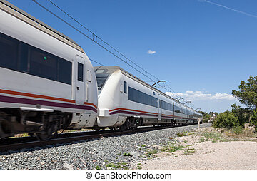 Passenger train - Fast moving passenger train with motion...