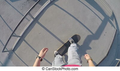 skateboarding at skatepark - young woman skateboarding at...