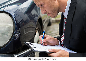 Man Filing Insurance Claim Form - Close-up Of A Man Filling...