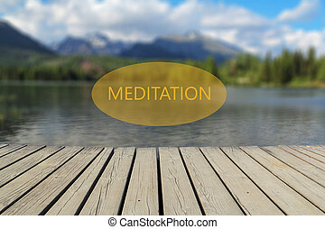 concept of meditation, mountain lake in the background