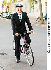 Happy Man In Suit Riding Bicycle