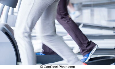 Pretty fit athletes are training in gym - Close-up of female...