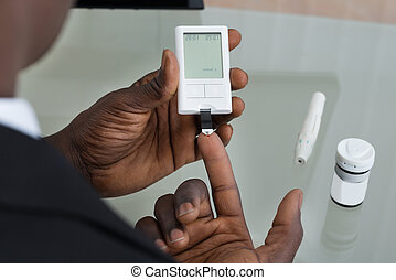 Patient Hands With Glucometer - Close-up Of Patient Hands...
