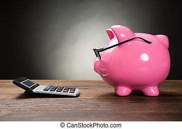 Pink Piggybank And Calculator - Piggybank With Eyeglasses...