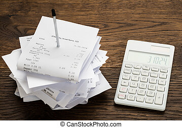 Receipts With Calculator On Table - High Angle View Of...