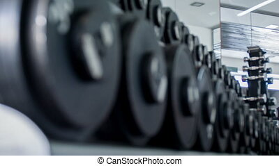 Iron heavy equipment for training in gym - Close up of black...