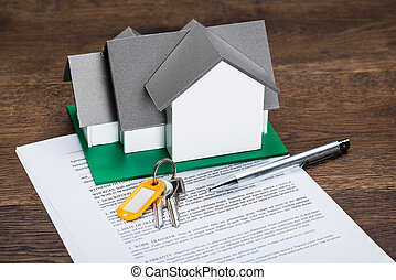 House Model And Contract Paper - House Model With Keys And...