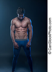 fit male model - Portrait of a muscular male model against...