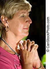 praying woman - a woman praying outdoors