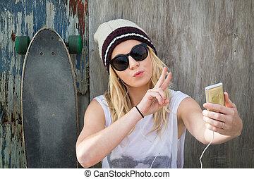 Skater Girl Taking Selfie - Cool skater girl taking selfie