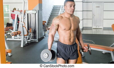 Handsome young man is lifting heavy equipment - Fit...