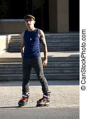 Inline skater standing in front of stairs - Young inline...