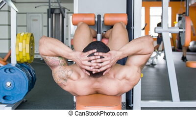 Handsome heavy-weight sportsman is exercising in gym -...