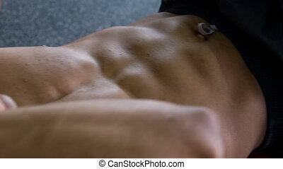 Beautiful young man is training his body - Close up of...