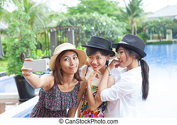 portrait of younger asian woman selfie by smart phone use...