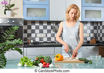 Young Woman Cooking. Healthy Food - Vegetable Salad.