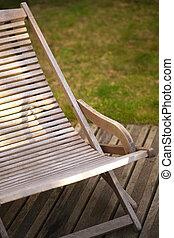 Deck chair - Wooden deck chair on a terrace in a garden