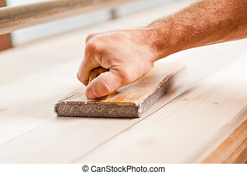 hand wood smoothing with belt sander