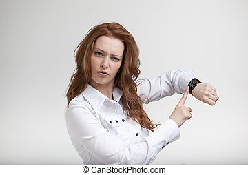 businesswoman in white blouse, looking at her watch - Young...