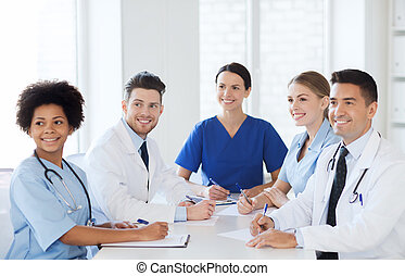 group of happy doctors meeting at hospital office -...