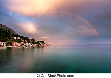 Rainbow over the Small Village in Omis Riviera after the...