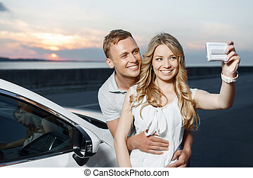 Lovely couple near the car - Lovely couple. Portrait of a...