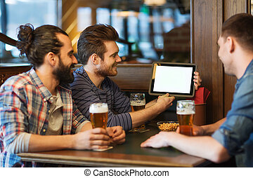 male friends with tablet pc drinking beer at bar - people,...