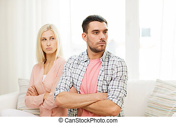 unhappy couple having argument at home - people,...