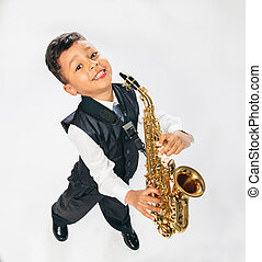 six years old boy plays saxophone at studio - 6 years old...