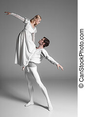 Two young ballet dancers practicing attractive dancing...
