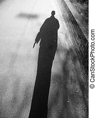 Shadow Man - A black and white shadowy image of a man