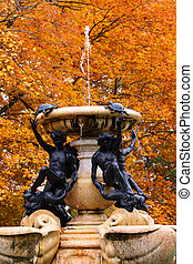 Historic fountain in Cranbrook house Michigan against autumn...