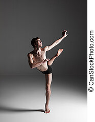 The young attractive modern ballet dancer on white...