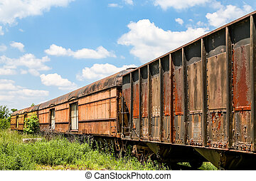 Old Rusty Train Cars Curving