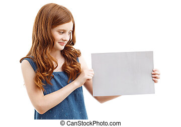 Positive little girl holding sheet of paper - Have a glance....