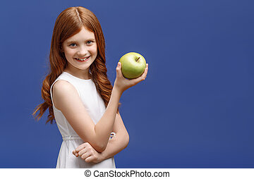 Nice little girl holding apple in one hand - Good choice....