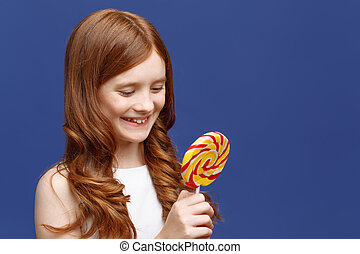 Pretty girl holding lollipop - Taste of happy childhood....