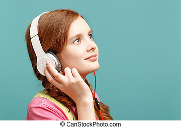 Pretty girl listening to music - Feeling delighted. Nice...
