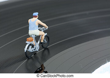 Two model people in cycle race - Model people having a cycle...