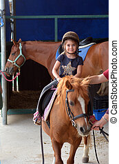 Young Horse riders - TEL AVIV - APR 21 2015:Little girl...